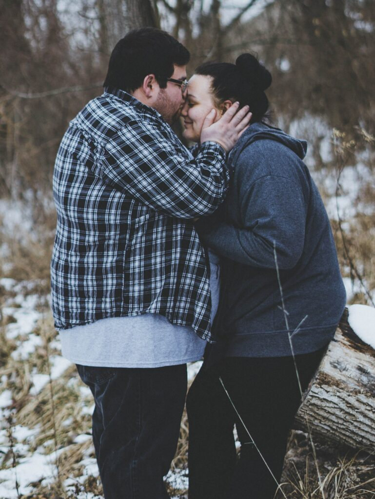 couples using gottman therapy and showing physical affection by kissing foreheads.